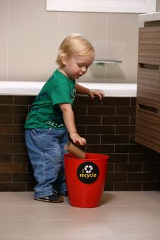 Toddler recycling in the bathroom © Claire Grant